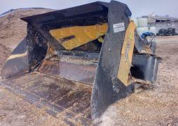 Godet adapté pour distribuer le sable dans les logettes